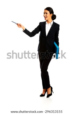 Smiling businesswoman holding a pen and binder. - stock photo