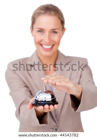 Smiling businesswoman holding a service bell against a white background