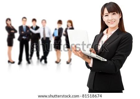 smiling businesswoman holding laptop and successful business team - stock photo