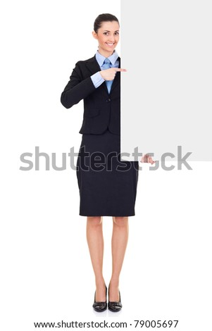smiling businesswoman holding white blank empty billboard, pointing, isolated on white background in full length - stock photo