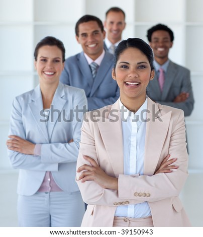 Smiling businesswoman leading her team in office