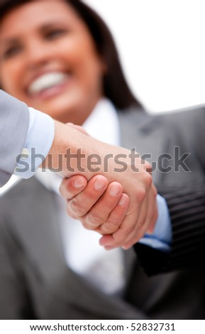 Smiling businesswoman looking at her partners shaking hands. Business concept. - stock photo