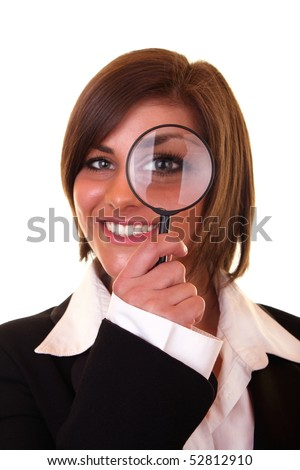 smiling businesswoman looking through a magnifying glass