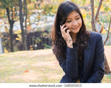 Smiling businesswoman making a phone call - stock photo