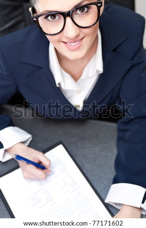 smiling businesswoman making note, top view - stock photo