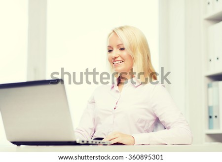 smiling businesswoman or student with laptop - stock photo