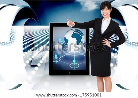 Smiling businesswoman pointing against abstract design in blue and white - stock photo