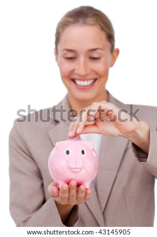 Smiling businesswoman saving money in a piggybank isolated on a white background
