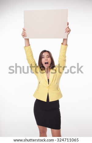 Smiling businesswoman showing board or banner with copy space on white background  - stock photo