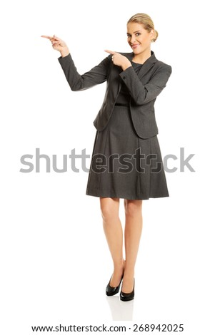 Smiling businesswoman showing copy space on the left. - stock photo