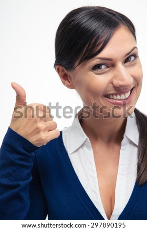 Smiling businesswoman showing thumb up isolated on a white background. Looking at camera - stock photo