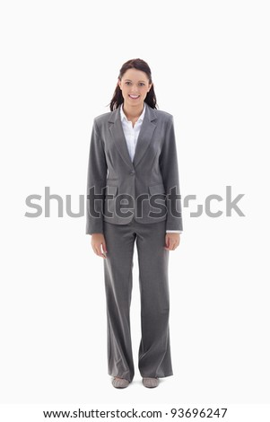 Smiling businesswoman standing against a white background