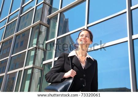 smiling businesswoman walking downtown - stock photo