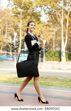 smiling businesswoman walking on street , outdoor - stock photo