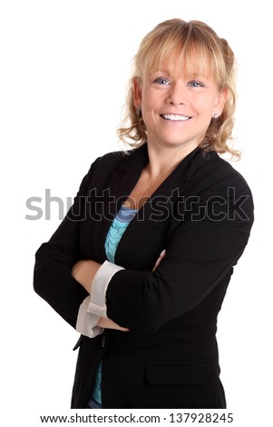 Smiling businesswoman wearing a jacket, her arms crossed. White background. - stock photo