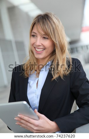 Smiling businesswoman with electronic tablet