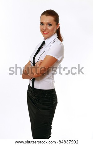 Smiling businesswoman with folded arms isolated - stock photo