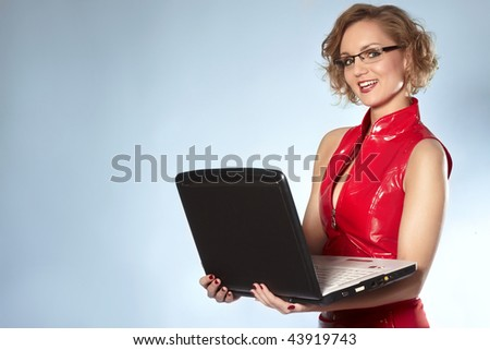 Smiling businesswoman with glass working at laptop