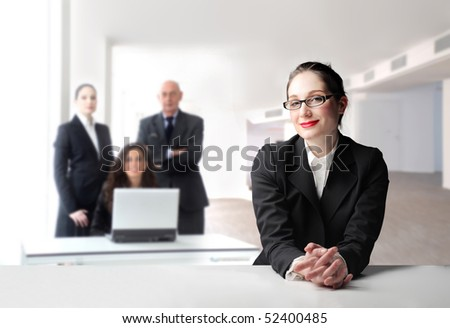 Smiling businesswoman with group of business people on the background - stock photo