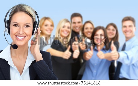 Smiling  businesswoman with headset and business people team.