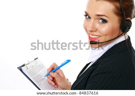 Smiling businesswoman with headset making notes. isolated on white background - stock photo