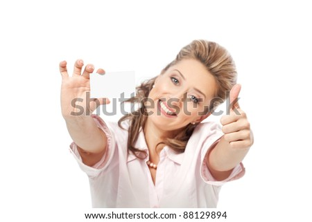 Smiling businesswoman with thumb up showing a blank business card isolated on a white background - stock photo