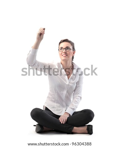 Smiling businesswoman writing - stock photo