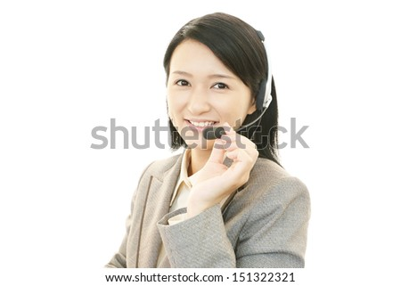 Smiling call center operator - stock photo