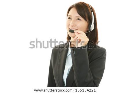 Smiling call center operator - stock photo