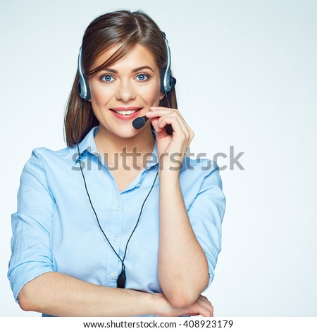 Smiling call center operator. Business woman. Headset touching. - stock photo