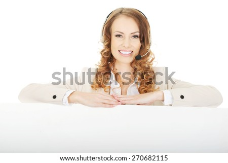 Smiling call center woman with empty banner. - stock photo