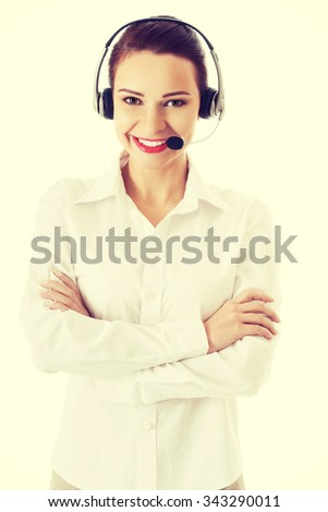 Smiling call center woman with folded arms. - stock photo