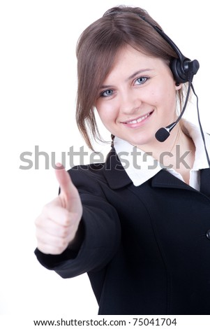 smiling call center young woman with a headset thumb up - stock photo