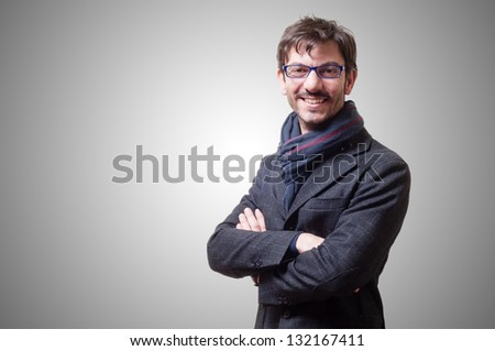 smiling casual business man with eyeglasses on gray background