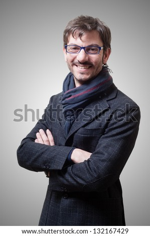 smiling casual business man with eyeglasses on gray background - stock photo