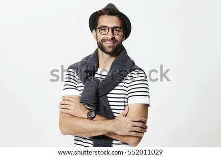 Smiling casual man in hat and spectacles, portrait