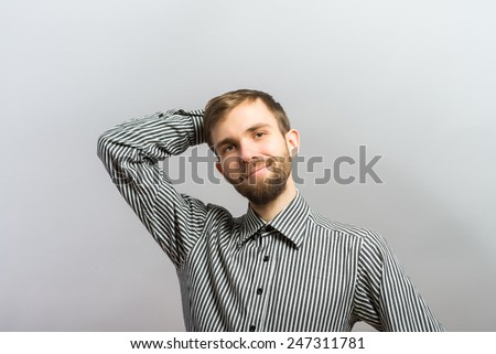smiling casual man relaxing with hands behind back - stock photo