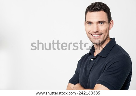 Smiling casual man with his crossed arms  - stock photo