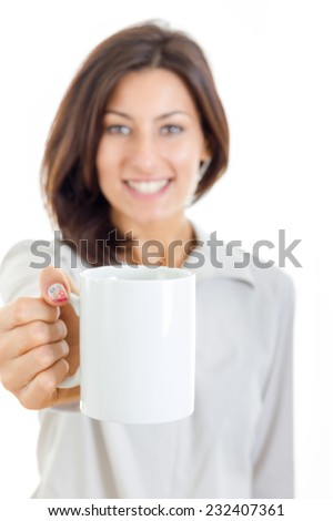 smiling casual pretty woman offered white cup of coffee or tea to you or to camera , socializing call and meeting photo , Hanging Out With Friends  , focus on cup - stock photo