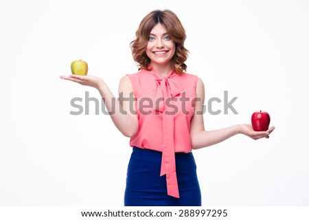 Smiling casual woman holding apples on palms isolated on a white background. Looking at camera