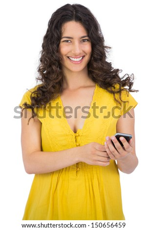 Smiling casual young woman on white background sending text message