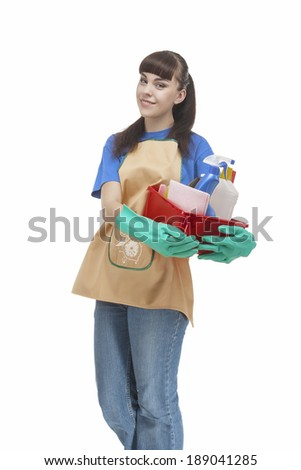 Smiling Caucasian Cleaner Woman With Lots of Accessories. Vertical image. Isolated on White - stock photo