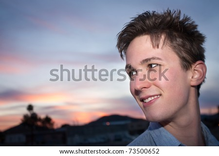 Smiling Caucasian man in an outdoor location - stock photo