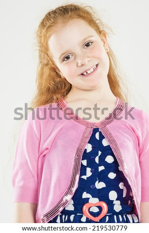 Smiling Caucasian Redhaired Little Girl.Standing Against White. Vertical Image Composition - stock photo