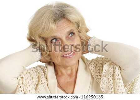 smiling charming groomed elderly woman on a white background