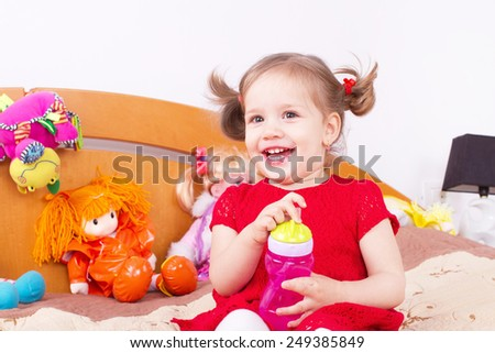 Smiling cheerful little girl - stock photo