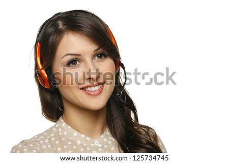 Smiling cheerful support phone operator woman in headset looking out of frame, isolated on white background - stock photo