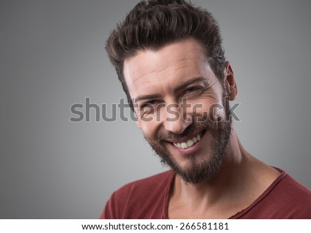 Smiling cheerful young man in t-shirt portrait close-up