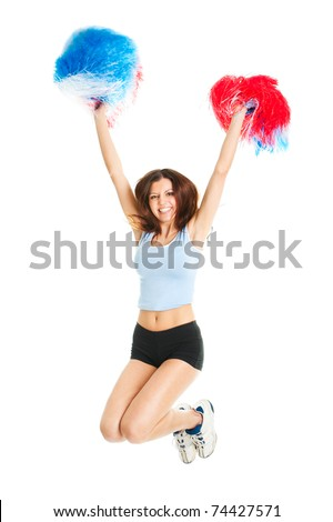 Smiling cheerleader girl posing with pom poms - stock photo
