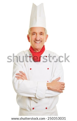 Smiling chef cook with his arms crossed in workwear - stock photo